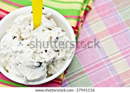 Chocolate chip cookie dough ice cream on a colorful background. Shallow DOF. - stock photo