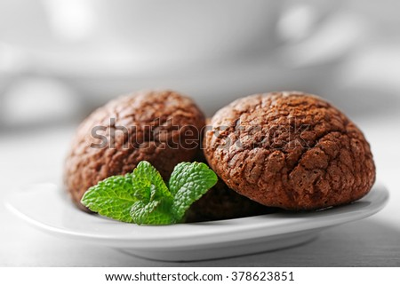 Chocolate chip cookie in plate with mint, closeup