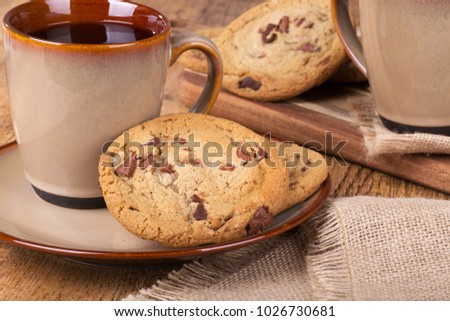 Chocolate chip cookies and a cup of coffee on a plate