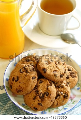 chocolate chip cookies and cup of tea - stock photo
