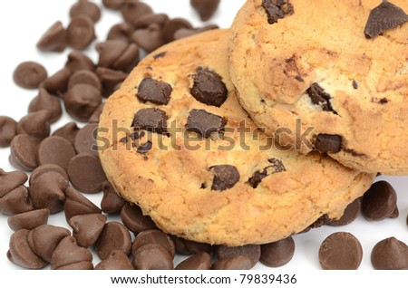 Chocolate chip cookies and morsels on white background macro shot with shallow dof - stock photo