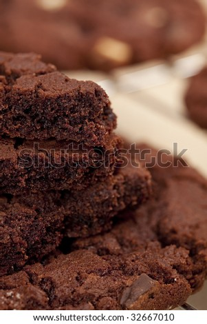 chocolate chip cookies broken on pieces and stacked , shallow DOF - stock photo