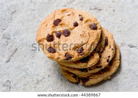 chocolate chip cookies on a concrete surface