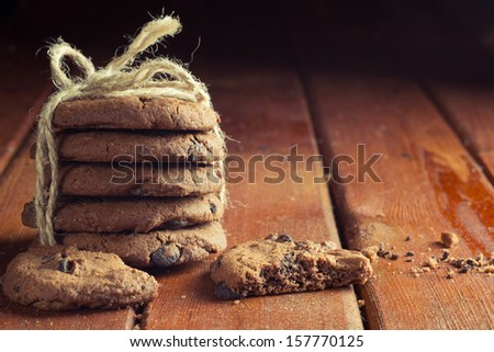 Chocolate chip cookies on a wooden table - stock photo