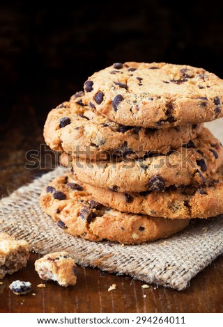 Chocolate chip cookies on old wooden table - stock photo