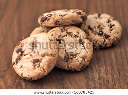 Chocolate chip cookies on wooden background - stock photo