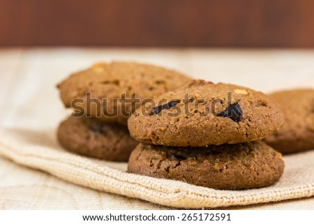 Chocolate chip cookies on wooden background. - stock photo