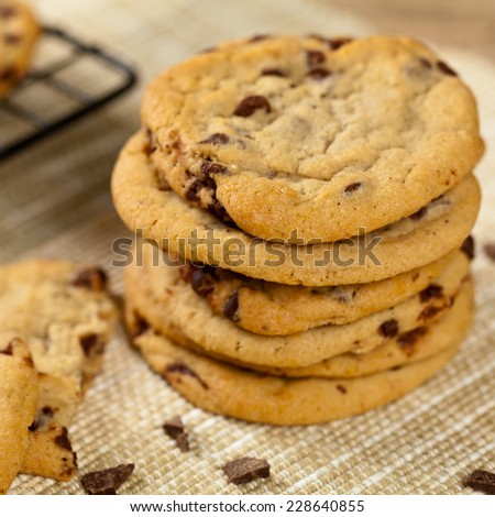Chocolate chip cookies on wooden table. Selective focus. - stock photo