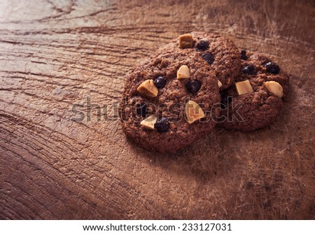 Chocolate chip cookies on wooden table. Stacked chocolate chip cookies close up - stock photo