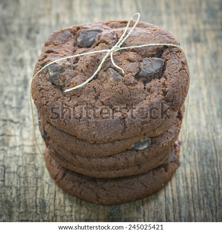 Chocolate chip cookies on wooden table. Stacked chocolate chip cookies close up.  - stock photo