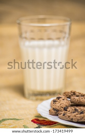 Chocolate chip cookies with a cup of milk - stock photo