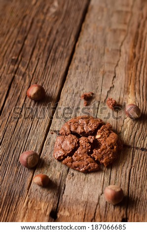chocolate chip cookies with walnuts on a wood background. toning.