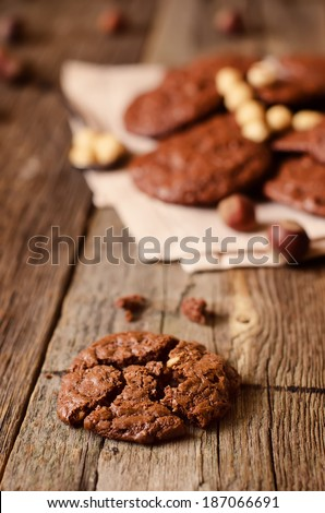 chocolate chip cookies with walnuts on a wood background. toning. focus on the middle cookies