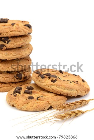 Chocolate chip cookies with wheat ears on white background - stock photo