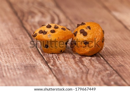 Chocolate Chip Mini Muffins on a rustic background - stock photo