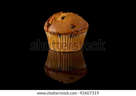 Chocolate Chip Muffin with Reflection on a Black Background