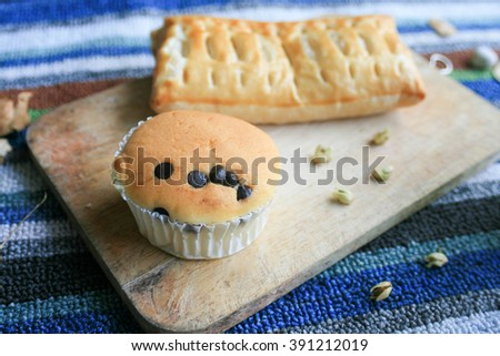 chocolate chip muffins and pie or cupcake with chocolate chip on wood board