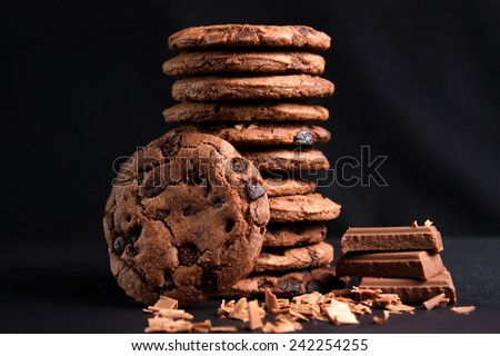Chocolate chips cookies isolated on black background - stock photo