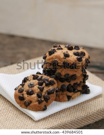 Chocolate chips cookies on white napkin.with space for text.