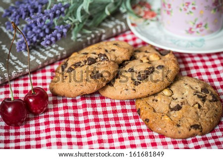 Chocolate chips cookies with a drink in the background