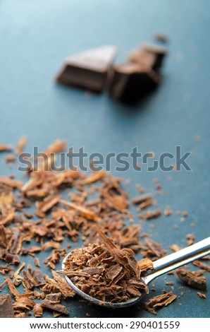 Chocolate chips on a spoon. Shallow depth of field. - stock photo