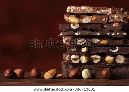 Chocolate / Chocolate bar / chocolate background/ nut chocolate / chocolate tower - stock photo