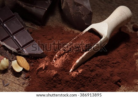 Chocolate / chocolate bar pieces / cocoa powder / chocolate background - stock photo