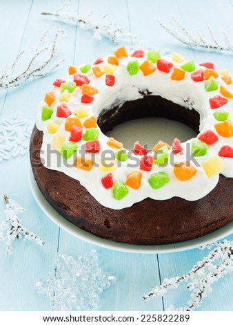 Chocolate Christmas cake with candies and whipped cream. Shallow dof. - stock photo