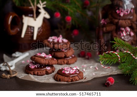 Chocolate Christmas Cookies with Chocolate Glaze and Crushed Candy Cane, copy space for your text