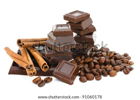 Chocolate,cinnamon and coffee beans. - stock photo
