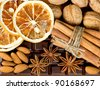 chocolate, cinnamon sticks, anise stars, nuts and sliced of dried orange. christmas spices background. sweet food - stock photo