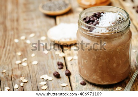 Chocolate Coconut Chia seeds overnight oats on a dark wooden background. toning. selective focus - stock photo