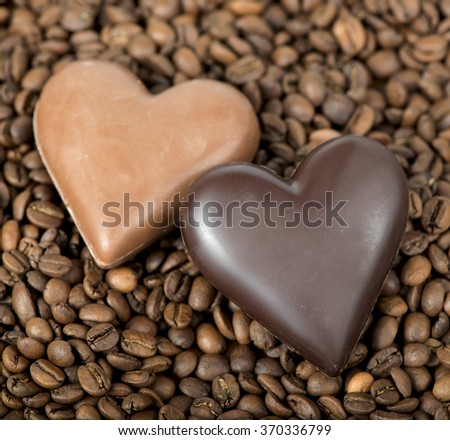 Chocolate-Coffee background. Chocolate heart and coffee beans. - stock photo