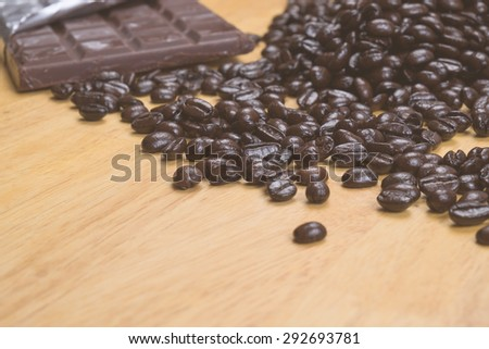 Chocolate Coffee bean on wooden desk - stock photo