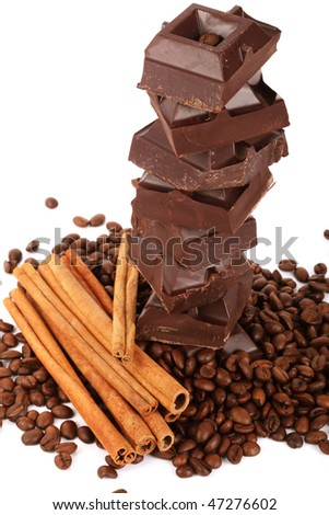 Chocolate,coffee beans and cinnamon isolated on a white background