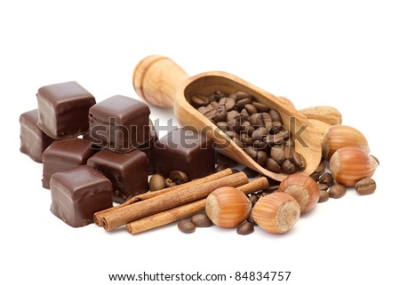 chocolate, coffee beans, cinnamon and nuts - stock photo