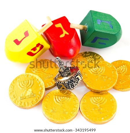 Chocolate coins and dreidels for Chanuka celebration. - stock photo