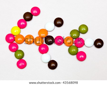 Chocolate colorful candies isolated on   background - stock photo