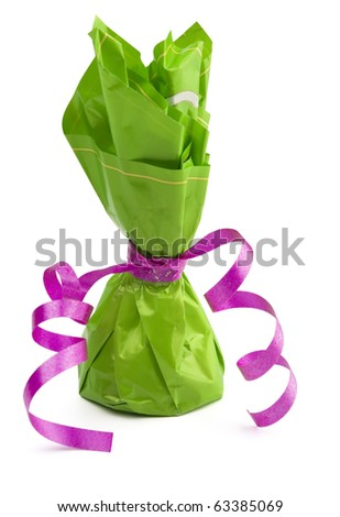 Chocolate  cone candy wrapped in green with pink ribbon isolated on white - stock photo