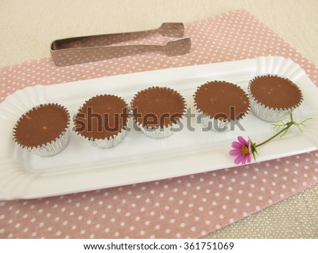 Chocolate confectionery in praline tins - stock photo