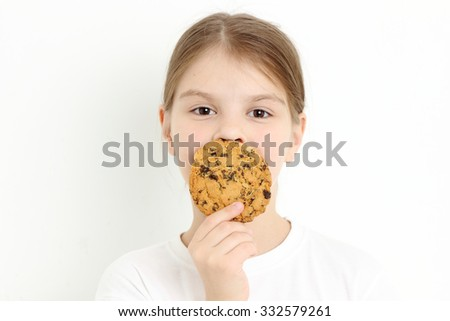 Chocolate cookie and lovely girl face - stock photo