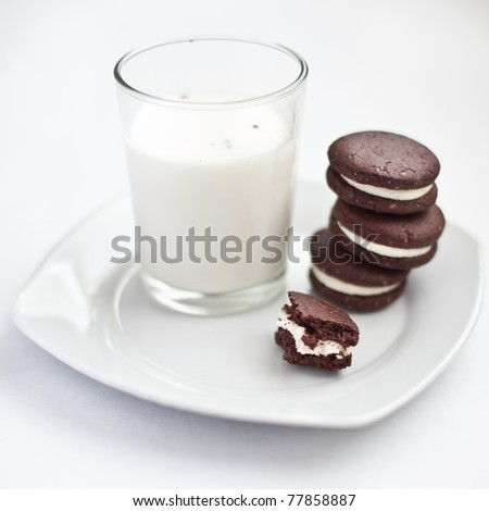 Chocolate cookies filed with cream - stock photo