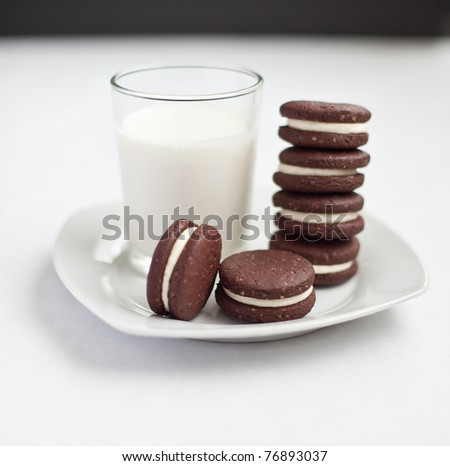 chocolate cookies filled with cream - stock photo