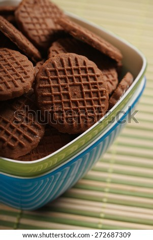 Chocolate cookies in bowl - close-up - stock photo
