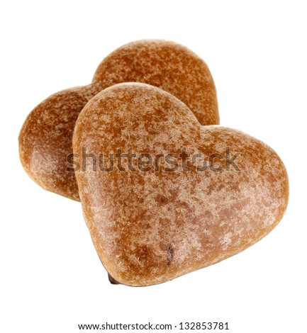 Chocolate cookies in form of heart isolated on white - stock photo
