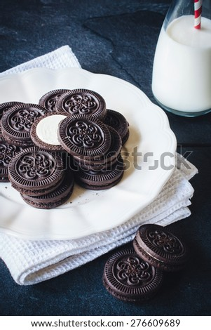 Chocolate cookies in the plate,selective focus  - stock photo