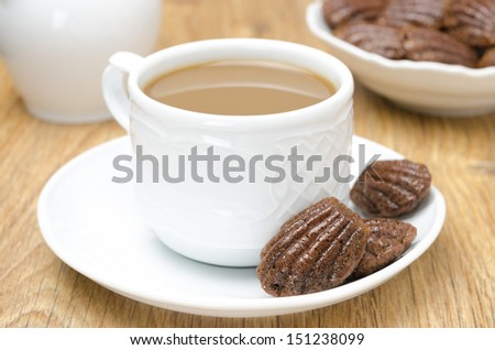 chocolate cookies madeleine and coffee with milk, close-up