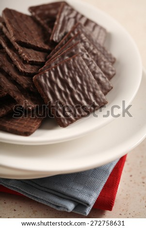 Chocolate cookies on white plate - stock photo