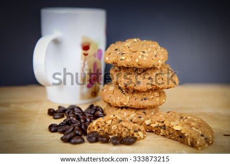 Chocolate cookies on wooden table. Chocolate chip cookies shot on coffee colored cloth, closeup. - stock photo