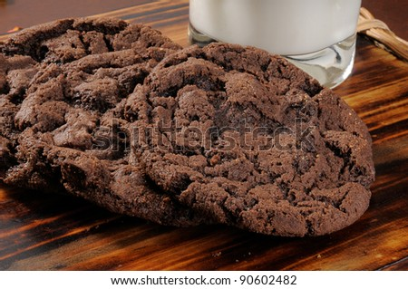 Chocolate cookies with a glass of milk - stock photo